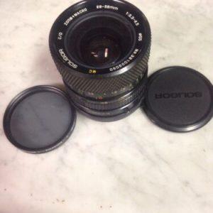Camera Marco 28-55mm AE. 1:3.3-4.5 SOLIGOR LENS W/Promaster Spectrum 7 Polarizer